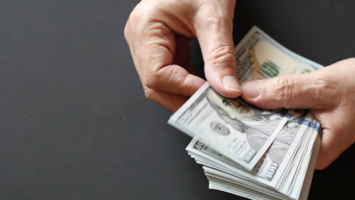 licking finger when couting money